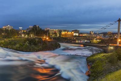 Dusk descends over Spokane Falls in Spokane, Washington State, USA