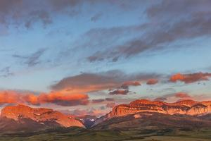 Early morning light on Old Man of the Hills and Walling Reef on the Rocky Mountain Front, Montana by Chuck Haney
