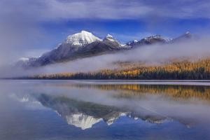 Fog at Rainbow Peak and Bowman Lake in Autumn in Glacier National Park, Montana by Chuck Haney