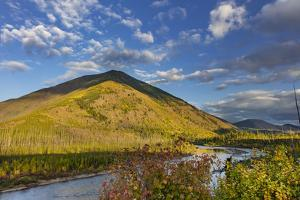 Huckleberry Mountain and The North Fork of the Flathead River in autumn in Glacier NP, Montana by Chuck Haney