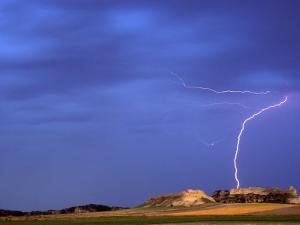 Lightning Strikes Buttes near Scottsbluff, Nebraska, USA by Chuck Haney