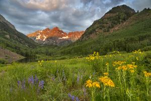 Maroon Bells reflect into calm Maroon Lake near Aspen, Colorado, USA by Chuck Haney