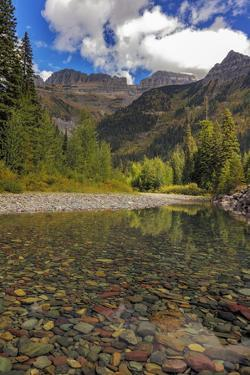 McDonald Creek with Garden Wall in early autumn in Glacier National Park, Montana, USA by Chuck Haney