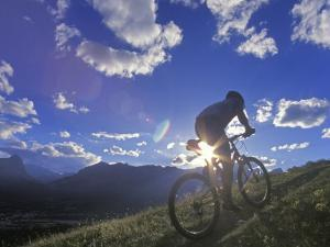 Mountain Biker at Sunset, Canmore, Alberta, Canada by Chuck Haney