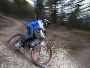Mountain Biker on Malice in Plunderland Trail, Spencer Mountain, Whitefish, Montana, USA by Chuck Haney