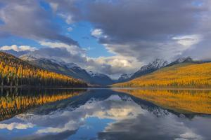 Mountain peaks reflect into Bowman Lake in autumn, Glacier National Park, Montana, USA by Chuck Haney