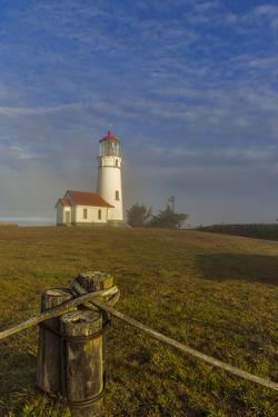 Oregons Oldest Lighthouse at Sunrise at Cape Blanco State Park, Oregon by Chuck Haney
