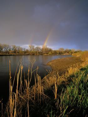 Rainbow over the North Platte River, Nebraska, USA by Chuck Haney