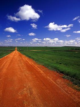 Red Road of Scoria near Fryburg, North Dakota, USA by Chuck Haney