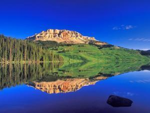 Reflection of Beartooth Butte into Beartooth Lake, Wyoming, USA by Chuck Haney