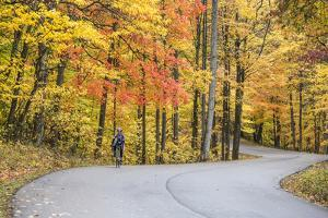 Road Bicycling in Autumn at Brown County State Park, Indiana, USA by Chuck Haney