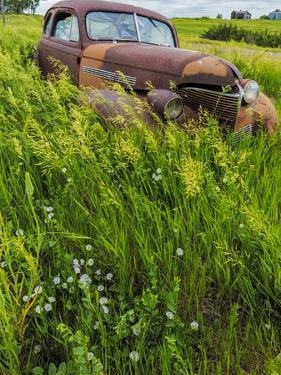 Rusty Old Vehicles in the Ghost Town of Okaton, South Dakota, Usa by Chuck Haney