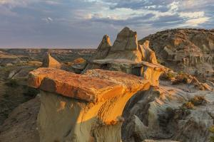 Sculpted badlands formations at first light in Theodore Roosevelt National Park, North Dakota, USA by Chuck Haney