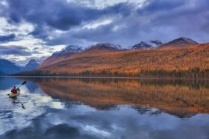 Sea kayaking on Bowman Lake in autumn in Glacier National Park, Montana, USA by Chuck Haney