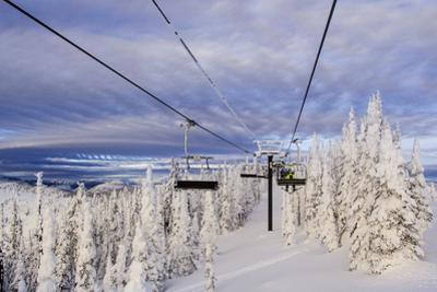 Skiers Ride Chairlift at Whitefish Mountain Resort, Montana, Usa