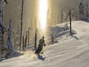 Skiing Through a Sundog on Corduroy Groomed Runs at Whitefish Mountain Resort, Montana, Usa by Chuck Haney