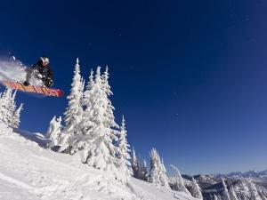 Snowboarding Action at Whitefish Mountain Resort in Whitefish, Montana, USA by Chuck Haney