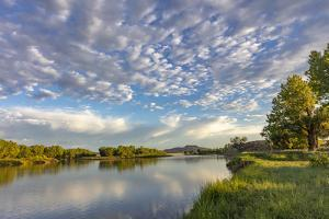 Sunrise and clouds over the Powder River near Terry, Montana, USA by Chuck Haney
