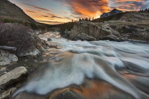 Sunrise Clouds over Swiftcurrent Falls, Glacier NP, Montana, USA by Chuck Haney