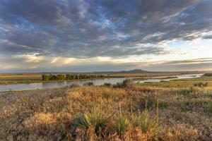 Sunrise over the Yellowstone River near Terry, Montana, USA by Chuck Haney