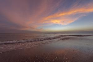 Sunset clouds over the Gulf of Mexico on Sanibel Island in Florida, USA by Chuck Haney