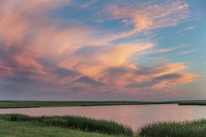 Sunset clouds reflecting at Medicine Lake National Wildlife Refuge, Montana, USA by Chuck Haney