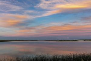Sunset clouds reflection at Medicine Lake National Wildlife Refuge, Montana, USA by Chuck Haney