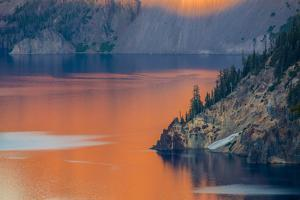 Sunset Colors the Waters at Crater Lake National Park, Oregon, Usa by Chuck Haney