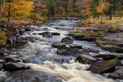 The Middle Branch of the Escanaba River Rapids in autumn, Palmer, Michigan USA by Chuck Haney