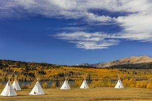 Tipis with Yellow Mountain, St. Mary, Montana, USA by Chuck Haney