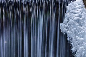 Water Flowes by Ice Formation Along Falls Creek in Winter Near Nelson, British Columbia, Canada by Chuck Haney