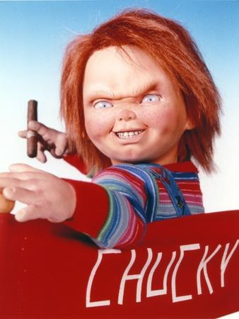 https://imgc.allpostersimages.com/img/posters/chucky-holding-tabaco-in-stripes-long-sleeve_u-L-Q1160TU0.jpg?artPerspective=n