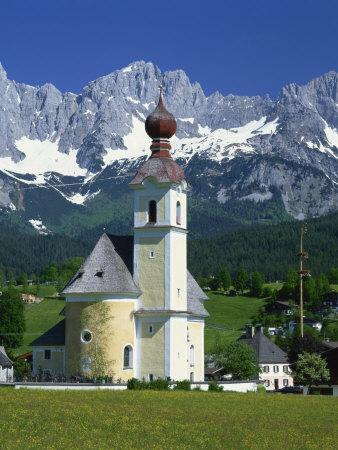 https://imgc.allpostersimages.com/img/posters/church-with-onion-dome-at-going-with-mountains-behind-in-the-tirol-austria-europe_u-L-P7XKBW0.jpg?p=0