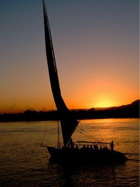 Felucca Silhouetted Against Setting Sun over the Nile at Luxor, Egypt by Cindy Miller Hopkins