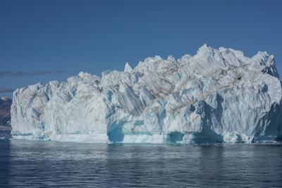 Greenland, Scoresbysund, aka Scoresby Sund, Nordvestfjord. Huge iceberg floating in calm fjord. by Cindy Miller Hopkins