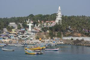 India, Kerala, Malabar Coast, Villanjam, Port view of fishing village with St. Joseph's Shrine. by Cindy Miller Hopkins