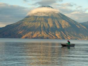 Reflections on Lake Atitlan with Fishing Boat, Panajachel, Western Highlands, Guatemala by Cindy Miller Hopkins