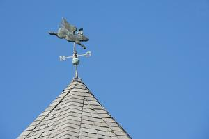 USA, Michigan, Mackinac Island. 'When Pigs Fly' rooftop weathervane. by Cindy Miller Hopkins