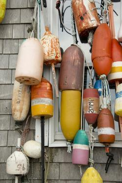 USA, Rhode Island, Block Island. Fishing buoys and floats on a wall. by Cindy Miller Hopkins