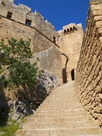 https://imgc.allpostersimages.com/img/posters/citadel-and-acropolis-of-lindos-rhodes-dodecanese-greek-islands-greece-europe_u-L-PFKWSR0.jpg?p=0