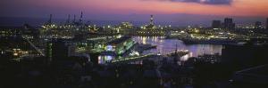 City at a Port Lit Up at Dusk, Genoa, Liguria, Italy