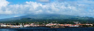 City on island with Pick Mountain in the background, Pico Island, Azores, Portugal