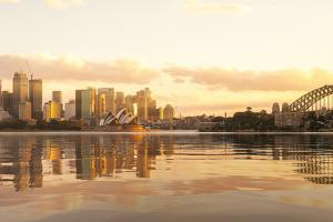 Cityscape of Sysney Harbour and Bridge with Morning Sunrise Moment and Boat in the Sea, New South W