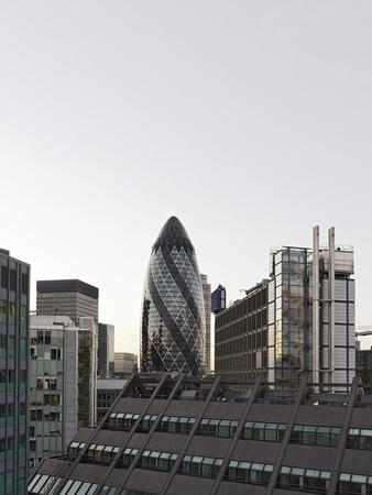 https://imgc.allpostersimages.com/img/posters/cityscape-with-swiss-re-tower-by-architect-sir-norman-foster-30-st-mary-axe-england_u-L-Q11YS2X0.jpg?p=0
