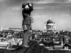 Civilian Aircraft Spotter Using Binoculars to Patrol Skies from Rooftop During the Days of Blitz
