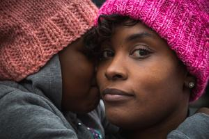 A Mother and Daughter Attend the Womens March Wearing the Event's Signature Pink Hats by Clare Fieseler