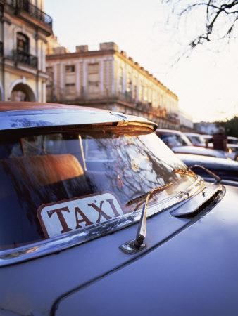 https://imgc.allpostersimages.com/img/posters/classic-american-car-with-taxi-sign-in-windscreen-havana-cuba-west-indies-central-america_u-L-P7NIQO0.jpg?artPerspective=n