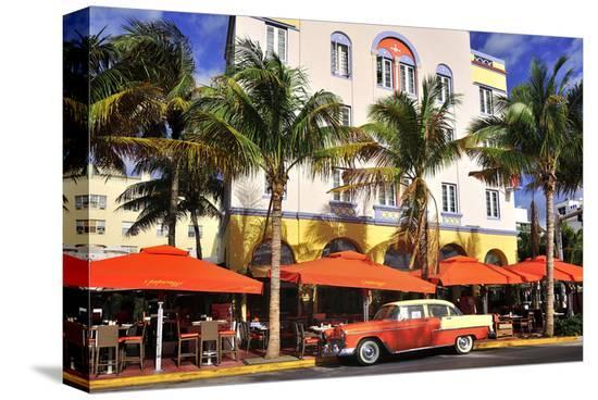 Classic Car in front of the Paparazzi Restaurant, Ocean Drive--Stretched Canvas Print
