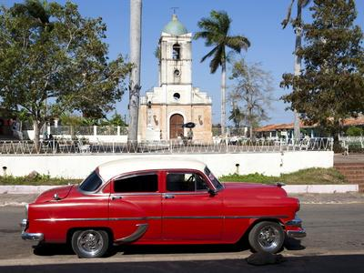 https://imgc.allpostersimages.com/img/posters/classic-red-american-car-parked-by-the-old-square-in-vinales-village-pinar-del-rio-cuba_u-L-PFO5NG0.jpg?p=0