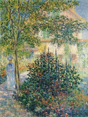 Camille Monet in the Garden at Argenteuil, 1876 by Claude Monet